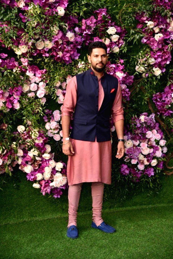 Cricketer Yuvraj Singh at the wedding festivities of Akash Ambani and Shloka Mehta in Mumbai on March 9, 2019. - Yuvraj Singh, Akash Ambani and Shloka Mehta