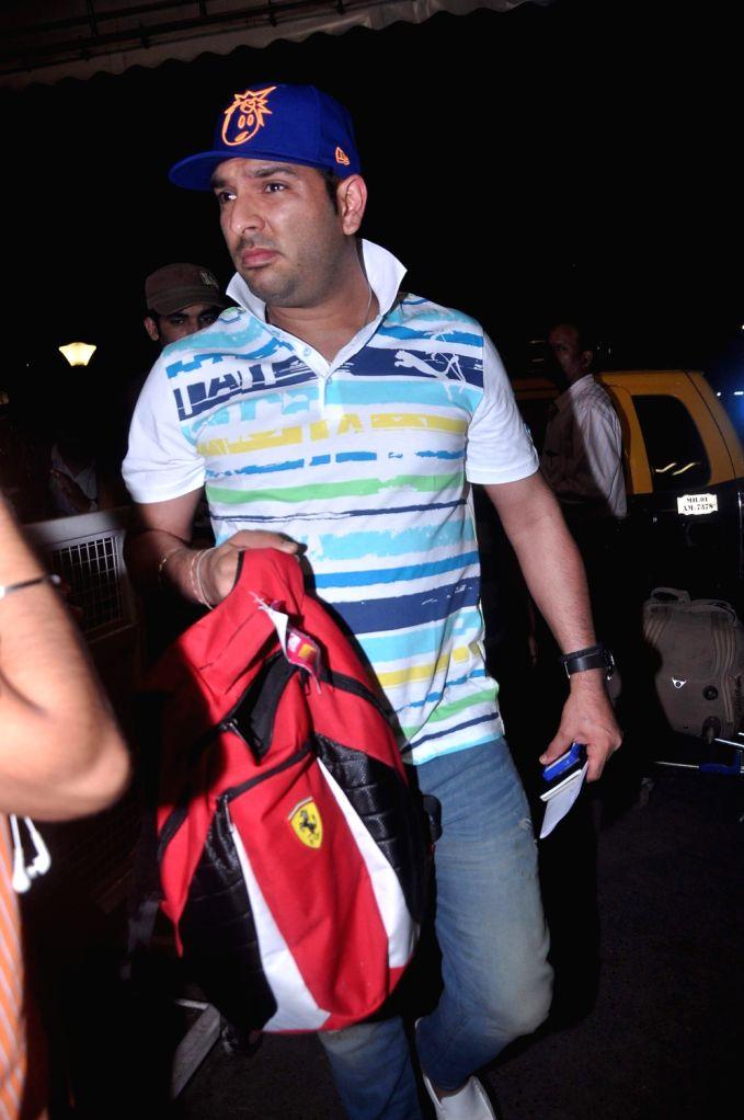 Cricketer Yuvraj Singh leave for 13th IIFA awards to Singapore at International Airport. - Yuvraj Singh