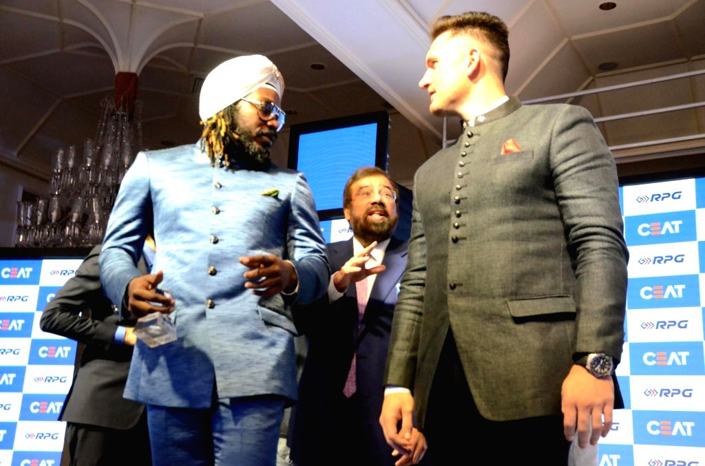 Cricketers Chris Gayle and Graeme Smith during Ceat cricket rating award 2017-18, in Mumbai on May 28, 2018.