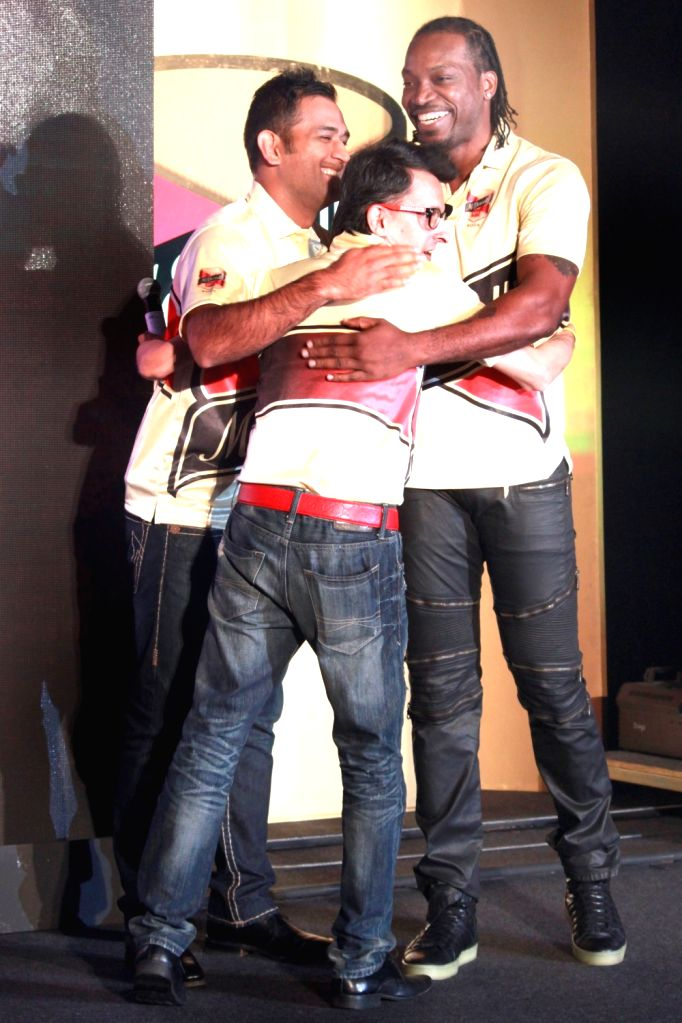 Cricketers Mahendra Singh Dhoni and Chris Gayle during a promotional programme in New Delhi, on Nov 2, 2015. - Mahendra Singh Dhoni