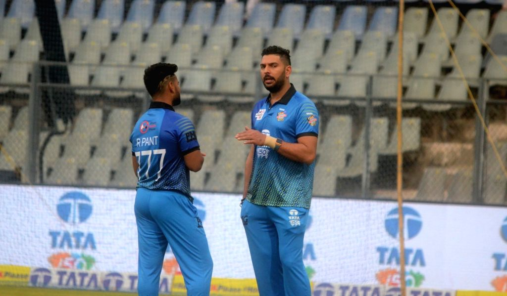 Cricketers Yuvraj Singh and Rishabh Pant in a conversation ahead of 'Horn Not Ok Please' T20 Cup match at Wankhede Stadium in Mumbai, on March 24, 2018. - Yuvraj Singh