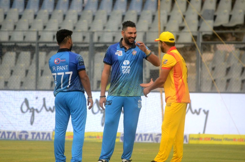 Cricketers Yuvraj Singh, Rishabh Pant and Suresh Raina in a conversation ahead of 'Horn Not Ok Please' T20 Cup match at Wankhede Stadium in Mumbai, on March 24, 2018. - Yuvraj Singh