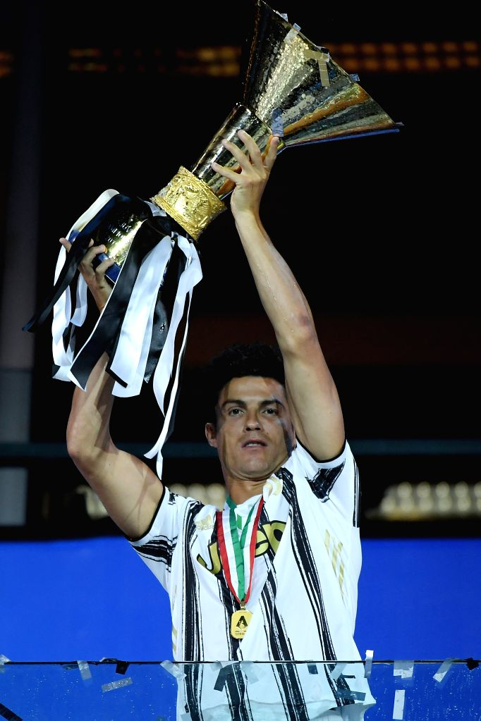 Cristiano Ronaldo of FC Juventus celebrates with the trophy at the end of the Serie A football match between FC Juventus and Roma in Turin, Italy, Aug 1, 2020.