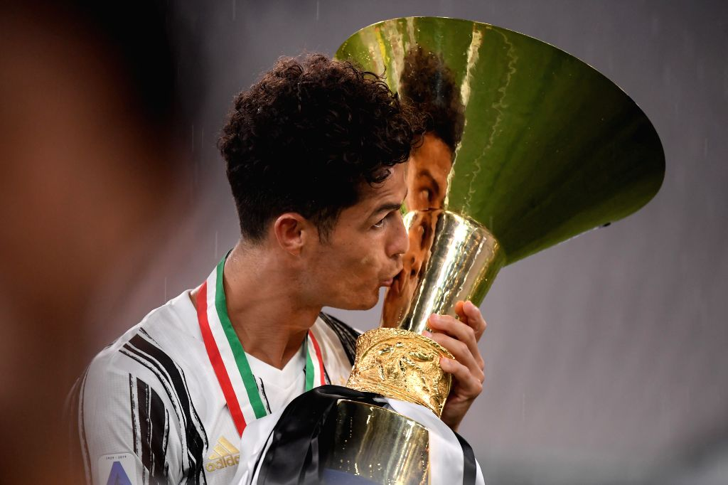 Cristiano Ronaldo of FC Juventus kisses the trophy at the end of the Serie A football match between FC Juventus and Roma in Turin, Italy, Aug 1, 2020.