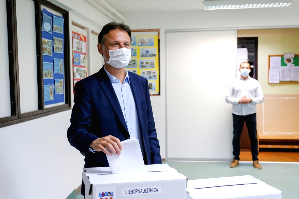 Croatian Parliament Speaker Gordan Jandrokovic casts his ballot at a polling station during the parliamentary elections in Zagreb, Croatia, on July 5, 2020. The ... - Gordan Jandrokovic