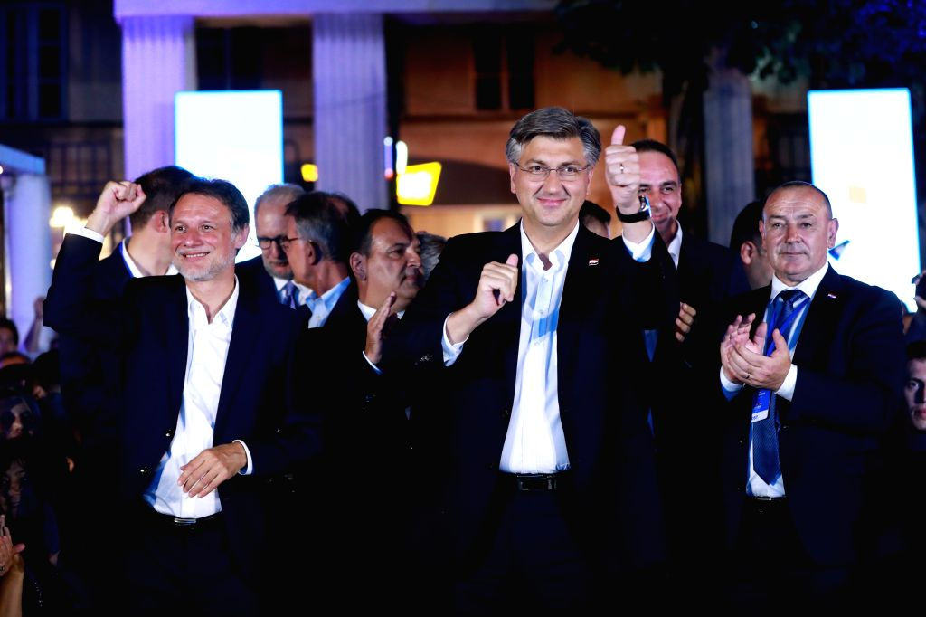 Croatian Prime Minister and leader of Croatian Democratic Union (HDZ) Andrej Plenkovic (C) celebrates HDZ's victory in parliamentary elections with Speaker of ... - Andrej Plenkovic