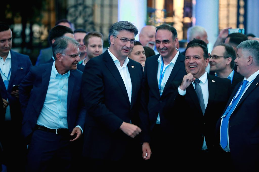 Croatian Prime Minister and leader of Croatian Democratic Union (HDZ) Andrej Plenkovic (2nd L) celebrates HDZ's victory in parliamentary elections with Tourism ... - Gari Cappelli