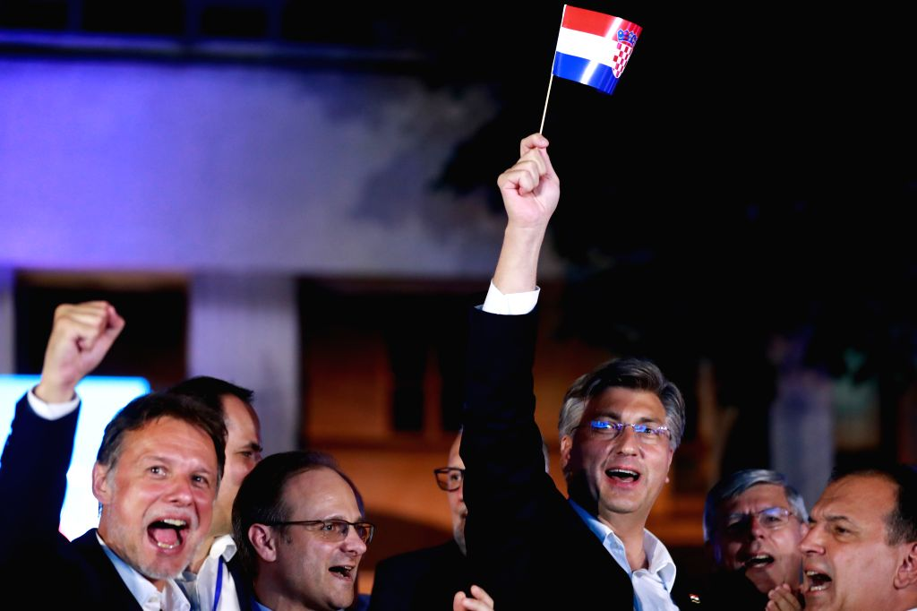Croatian Prime Minister and leader of Croatian Democratic Union (HDZ) Andrej Plenkovic (C) celebrates HDZ's victory in parliamentary elections in Zagreb, Croatia, ... - Andrej Plenkovic