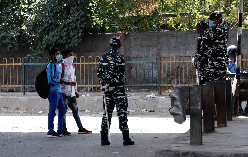 CRPF personnel deployed at the Delhi-Faridabad Border that has been sealed in the wake of the countrywide lockdown imposed to contain the spread of novel coronavirus, on March 30, 2020.