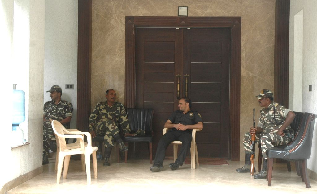 CRPF personnel patrolling the residence of Karnataka Energy Minister DK Shivakumar during the Income Tax department raids in Bengaluru on Aug 4, 2017. - D