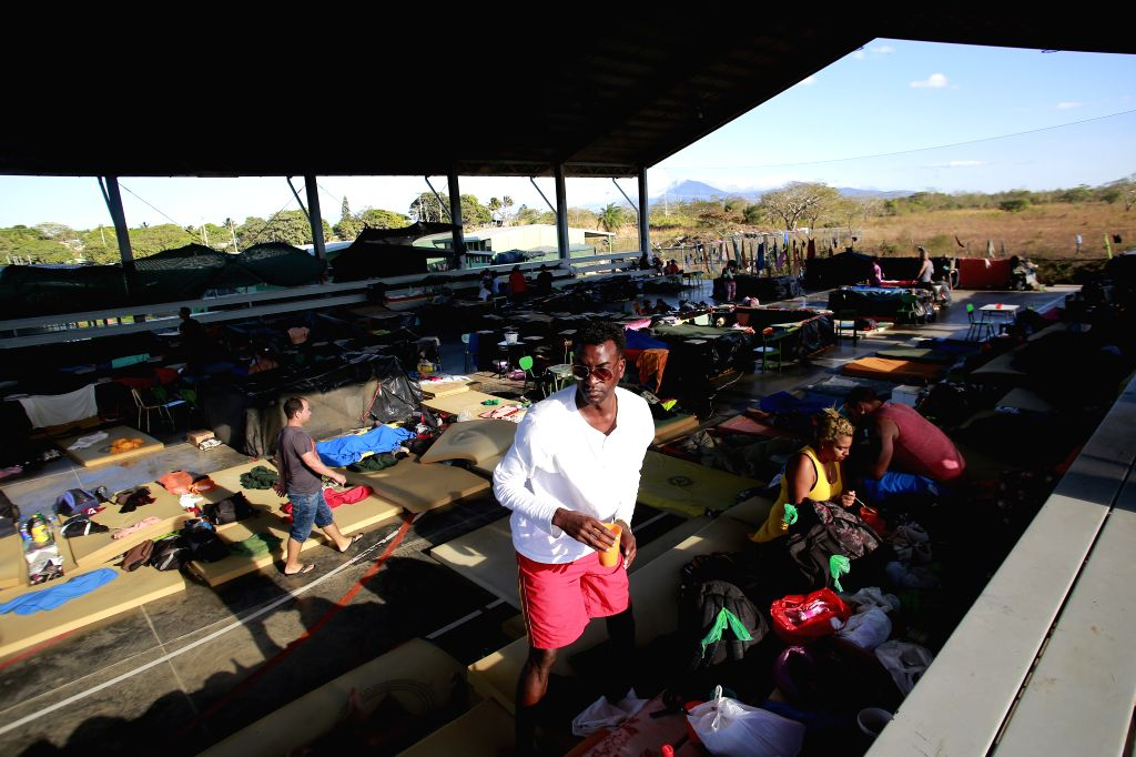 Cuban migrants arrange their belongings at a shelter in La Cruz, Costa Rica, on Jan. 13, 2016. Mexico received on Wednesday the first group of 180 Cuban migrants, ...