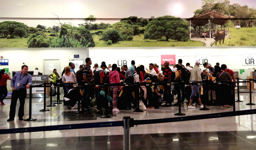 Cuban migrants arrive at Daniel Oduber International Airport, in Liberia, Costa Rica, on Jan. 12, 2016. A group of around 180 Cuban migrants were to be put on a ... - Manuel Gonzalez