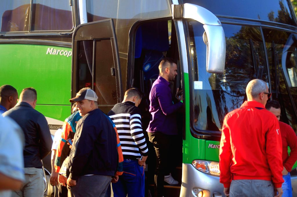 Cuban migrants board a bus at the border of El Salvador and Guatemala near Guatemala's southern department of Escuintla, on Jan. 13, 2016. Mexico received on ...
