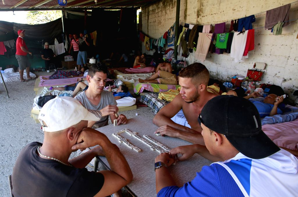 Cuban migrants play dominoes at a shelter in La Cruz, Costa Rica, on Jan. 13, 2016. Mexico received on Wednesday the first group of 180 Cuban migrants, out of ...
