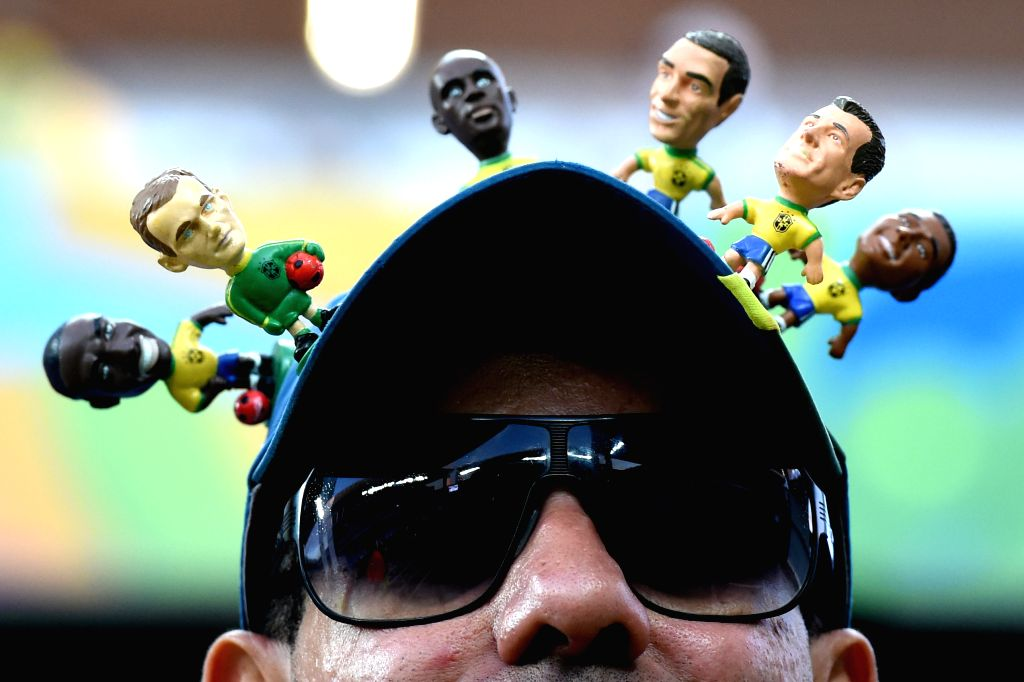 A fan is seen before a Group H match between Russia and Korea Republic of 2014 FIFA World Cup at the Arena Pantanal Stadium in Cuiaba, Brazil, June 17, ...