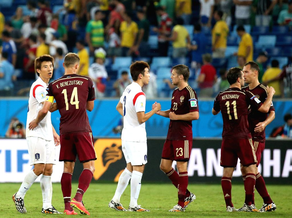 Players greet each other after a Group H match between Russia and Korea Republic of 2014 FIFA World Cup at the Arena Pantanal Stadium in Cuiaba, Brazil, June 17, ...