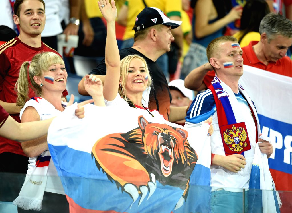 Russia's fans cheer during a Group H match between Russia and Korea Republic of 2014 FIFA World Cup at the Arena Pantanal Stadium in Cuiaba, Brazil, June 17, 2014. ..