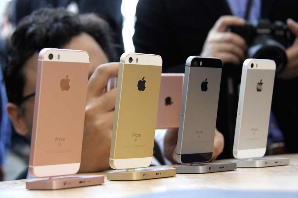 CUPERTINO, March 22, 2016 - Visitors take photos of the new iPhones, named iPhone SE, during an event to announce new products at Apple's headquarters in Cupertino, California, the United States, ...