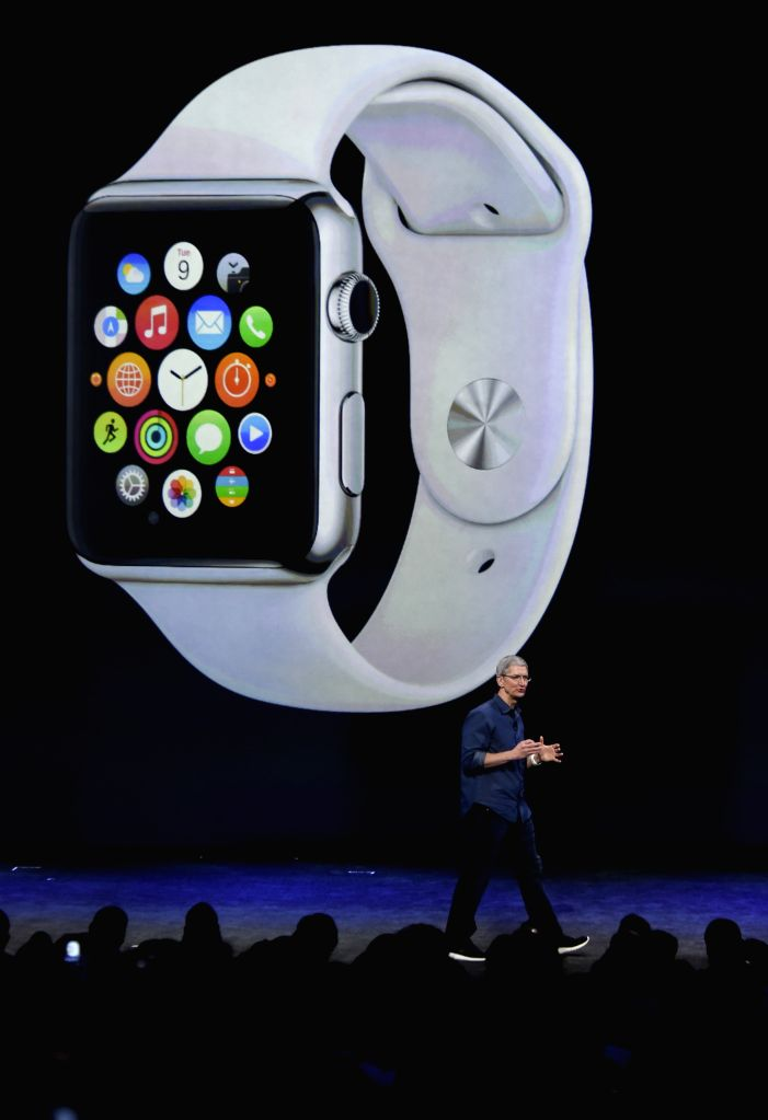 Apple CEO Tim Cook introduces the new products during an Apple special event in Cupertino, California, the United States, on Sept. 9, 2014.