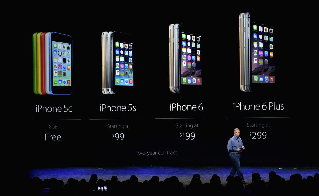 Apple Vice President Phil Schiller introduces the new products during an Apple special event in Cupertino, California, the United States, on Sept. 9, 2014. ...