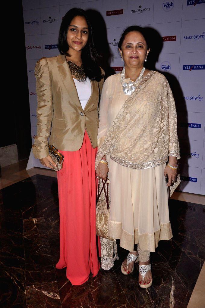 Curator Kalpana Shah along with her daughter during Make a Wish Foundation event in Mumbai, India on April 26, 2014. - Kalpana Shah