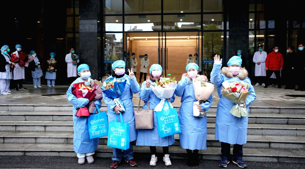 Cured novel coronavirus pneumonia patients are discharged from a hospital in Wuhan, central China's Hubei Province, Feb. 6, 2020. A total of 23 novel coronavirus ...