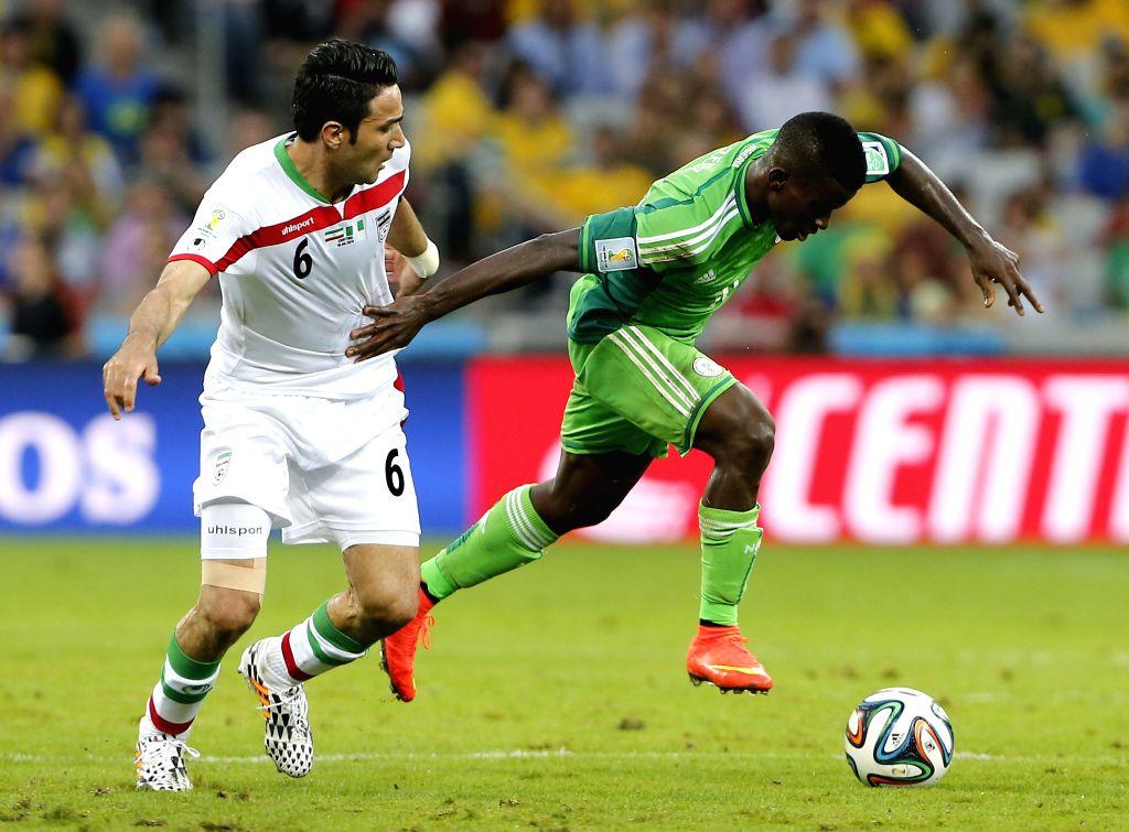 Nigeria's Ramon Azeez breaks through during a Group F match between Iran and Nigeria of 2014 FIFA World Cup at the Arena da Baixada Stadium in Curitiba, Brazil, ...
