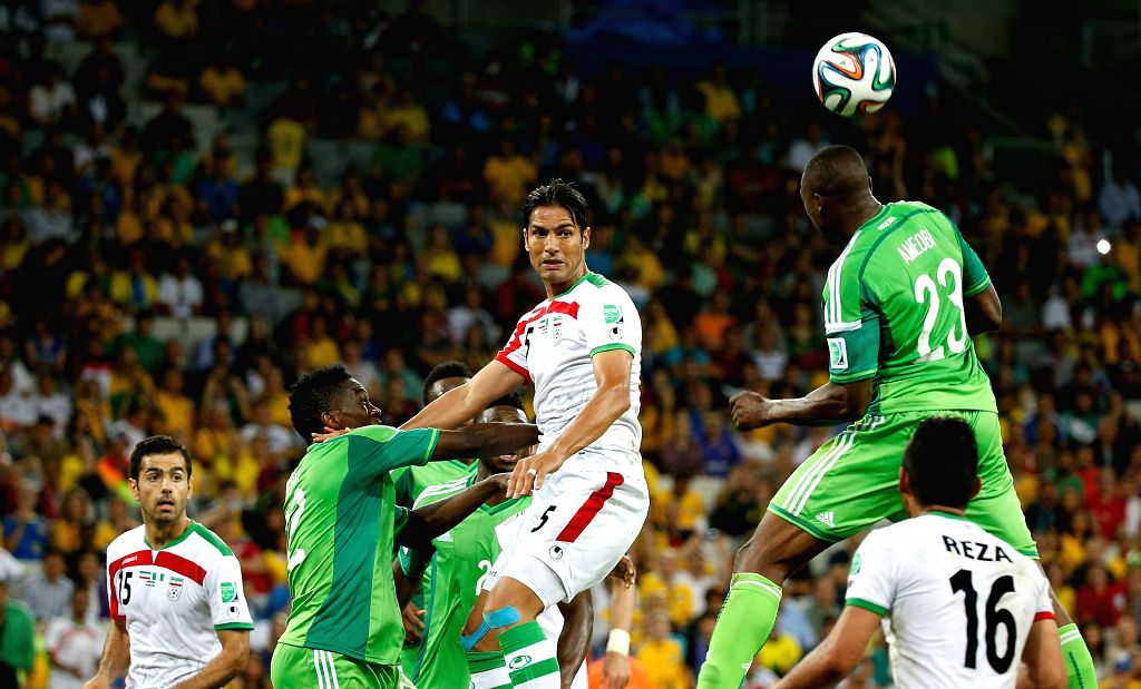 Nigeria's Shola Ameobi (R) competes for the ball during a Group F match between Iran and Nigeria of 2014 FIFA World Cup at the Arena da Baixada Stadium in ...
