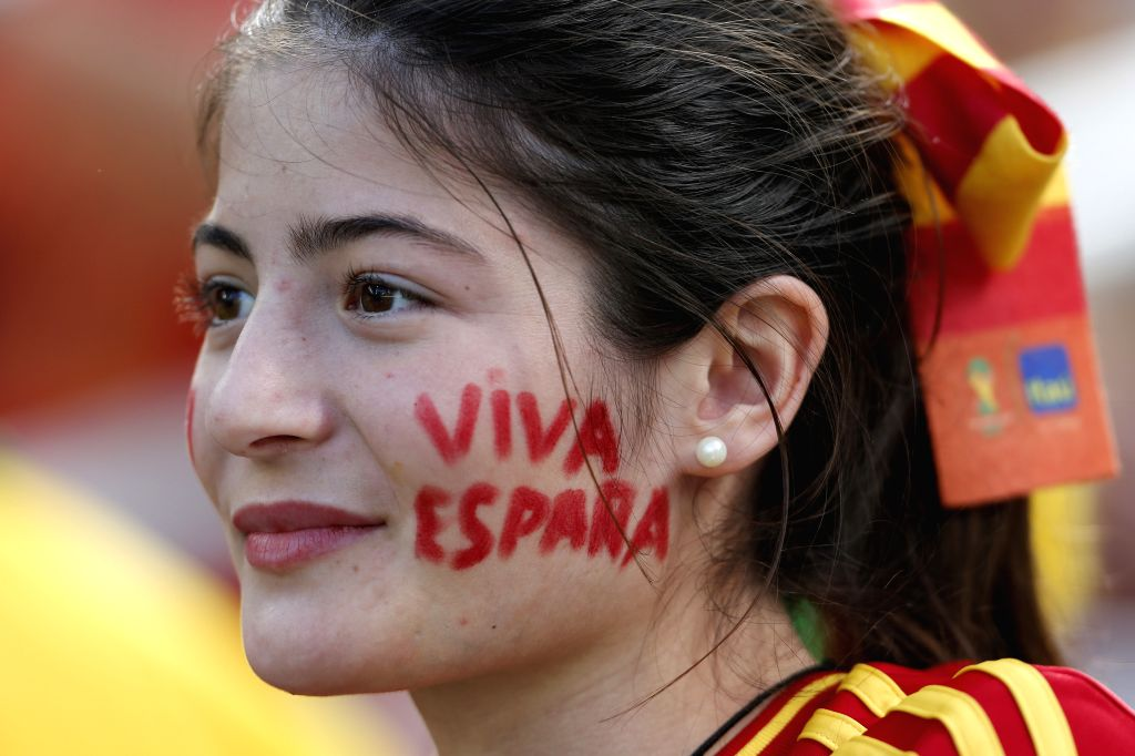 A supporter of Spain waits for a Group B match between Australia and Spain of 2014 FIFA World Cup at the Arena da Baixada Stadium in Curitiba, Brazil, on June 23, .