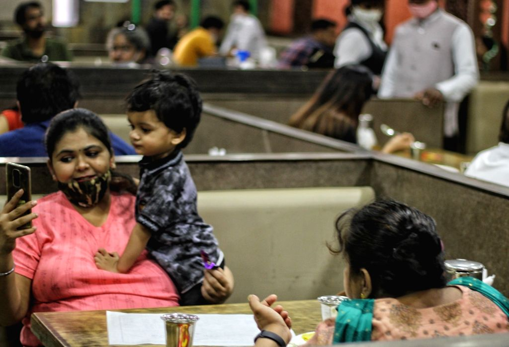 Customers eating at a restaurant after DDMA orders for reopening at Connaught place in New Delhi on Monday June 14, 2021