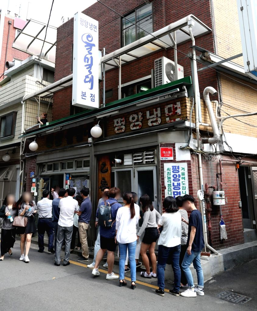 "Customers line up on Sept. 18, 2018, at a restaurant in Seoul that sells Pyongyang-style ""naemgmyeon,"" cold noodles served in broth or mixed with spice that originated in North ..."