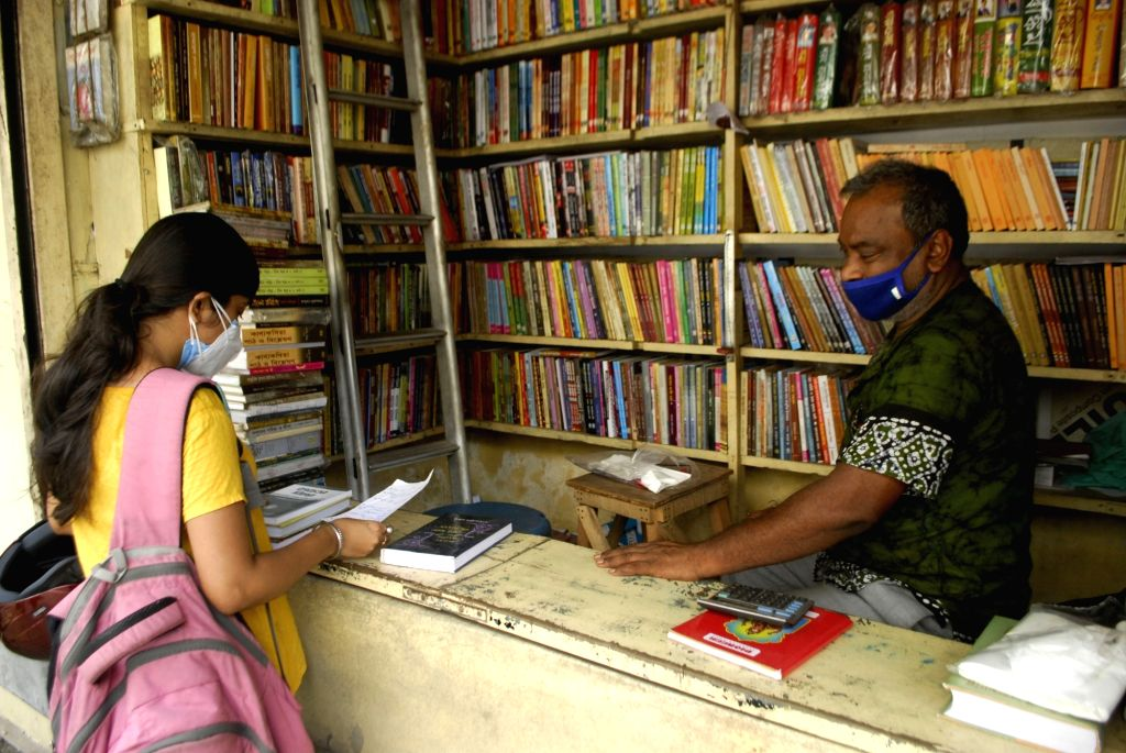 Customers purchase books from book stalls at College street Book market after authority restricted permissions of Covid 19 in Kolkata on Tuesday 08 June, 2021.