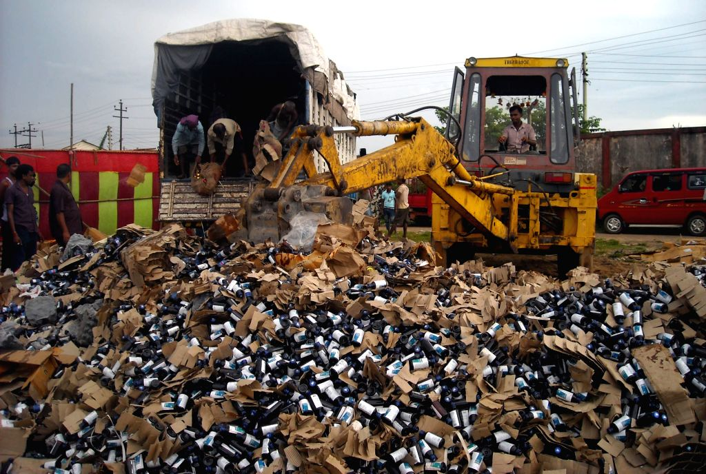 Customs officials destroy drugs -cough syrup and tablets- worth  Rs 80 lakh in an anti-narcotic drive in Agartala, on Aug 17, 2015.