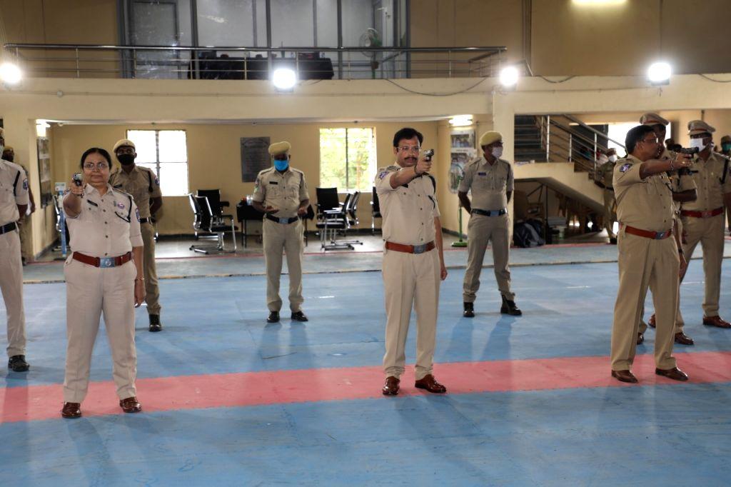 Cyberabad CP Sajjanar points a gun at a firing camp at IITA in Moinabad on September 12, 2020.