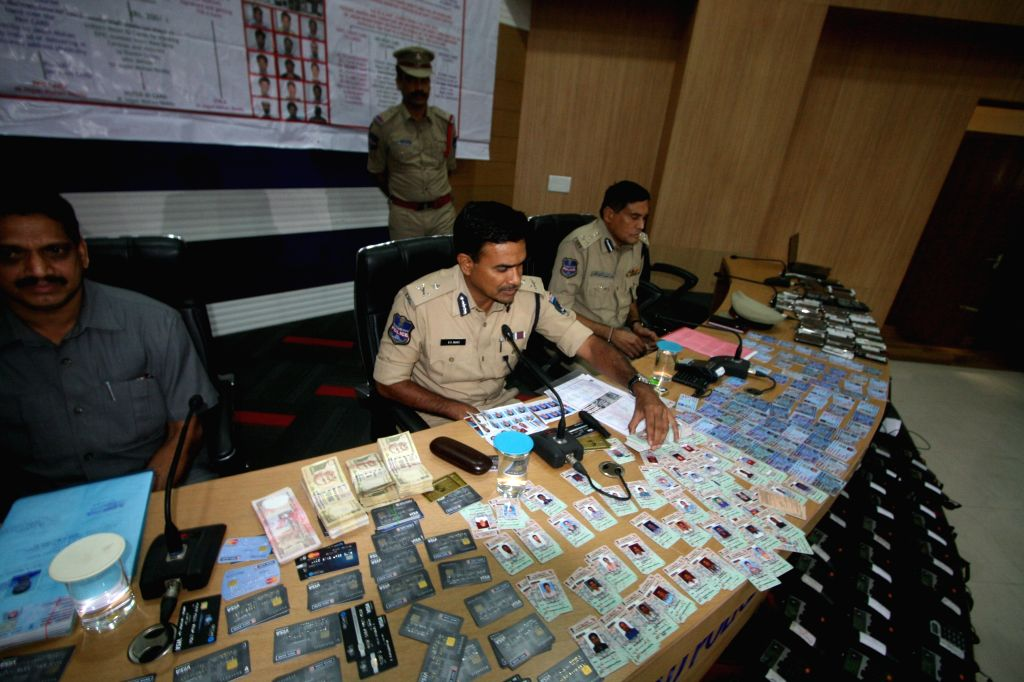 Cyberabad Police Commissioner C V Anand presents before press fake documents in Hyderabad on Aug 18, 2015.