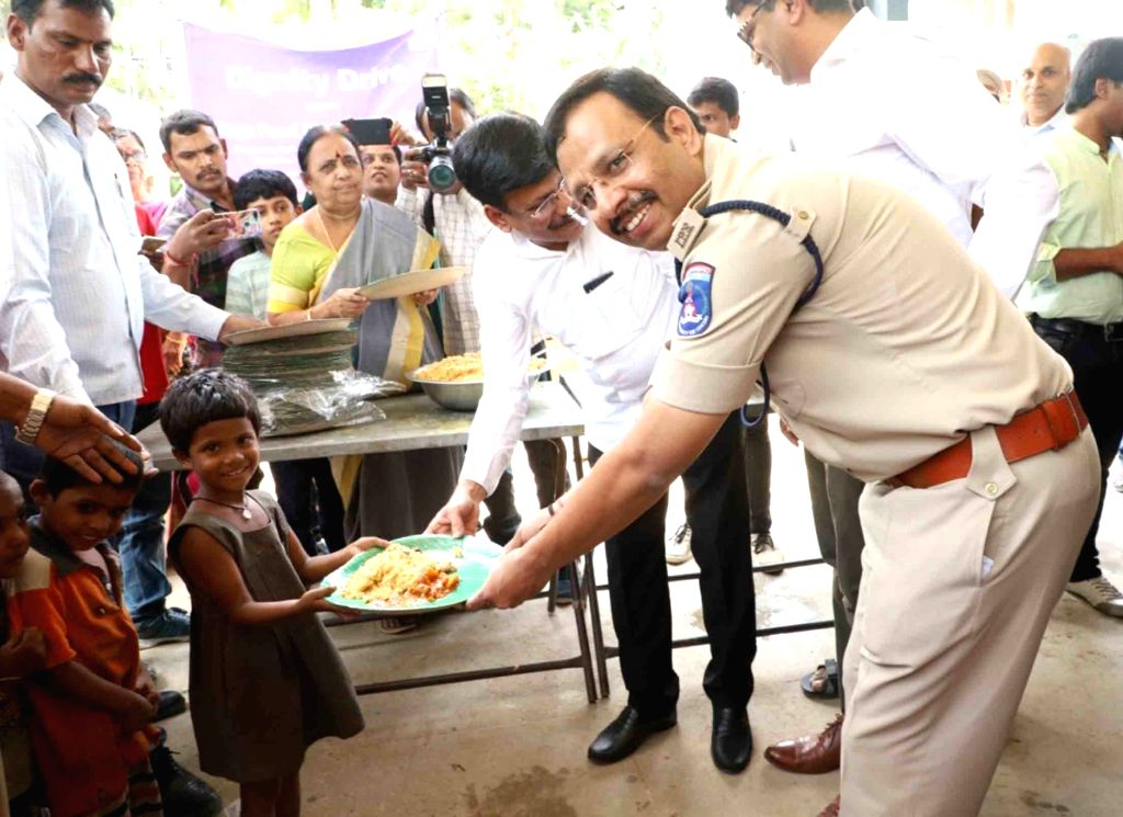 Cyberabad Police Commissioner V. C. Sajjanar distributes food among the needy during 'Dignity Drive' in Hyderabad on Sep 14, 2019.