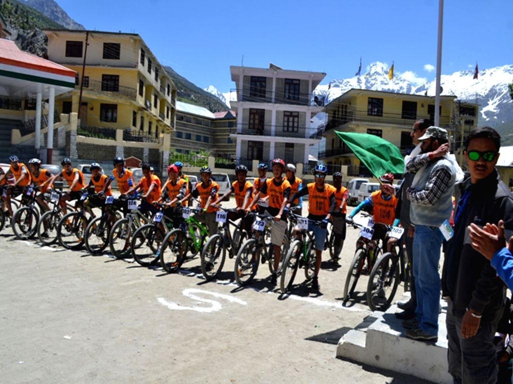 Cyclists participate during a cycle race organised on the eve of 'World Enviorment Day' at Keylong in Lahaul and Spiti district of Himachal Pradesh on June 4, 2016.