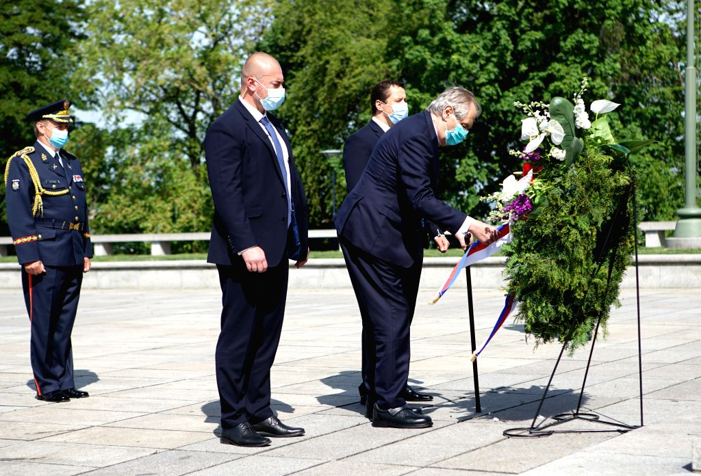 Czech President Milos Zeman (1st R) lays a wreath at the Tomb of the Unknown Soldier to mark the 75th anniversary of the end of World War II in Europe in Prague, the ...