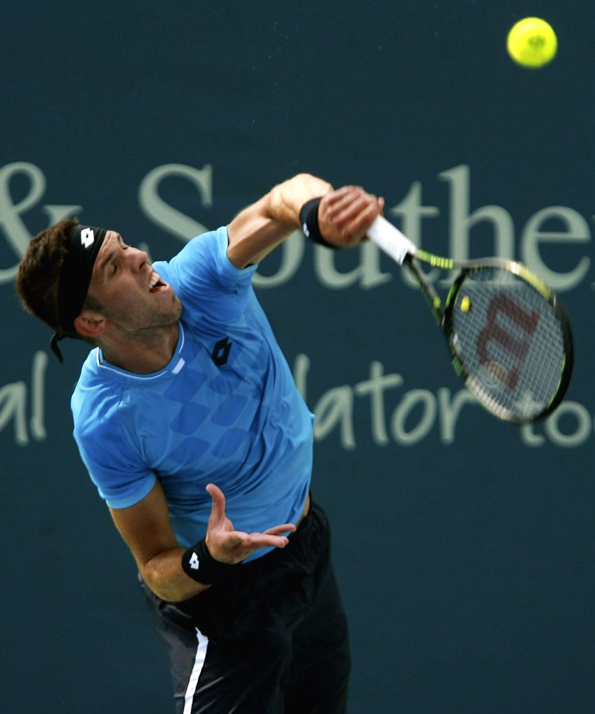 Czech tennis player Jiri Vesely serves to Brazilian Thomaz Bellucci during their Cincinnati tournament first round match at the Lindner Tennis Center of Mason, Ohio (United States), 17 August 2015. ...