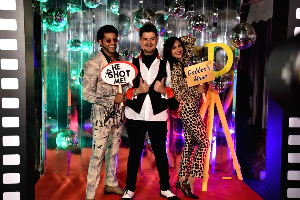 Dabboo Ratnani with actor Karanvir Bohra and his wife Teejay Sidhu at the launch of his calendar in Mumbai, on Jan 28, 2019. - Karanvir Bohra