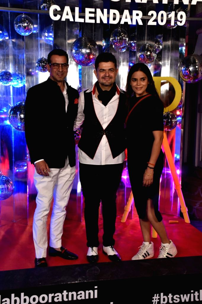 Dabboo Ratnani with actor Ronit Roy and his wife Neelam Singh at the launch of his calendar in Mumbai, on Jan 28, 2019. - Ronit Roy and Neelam Singh