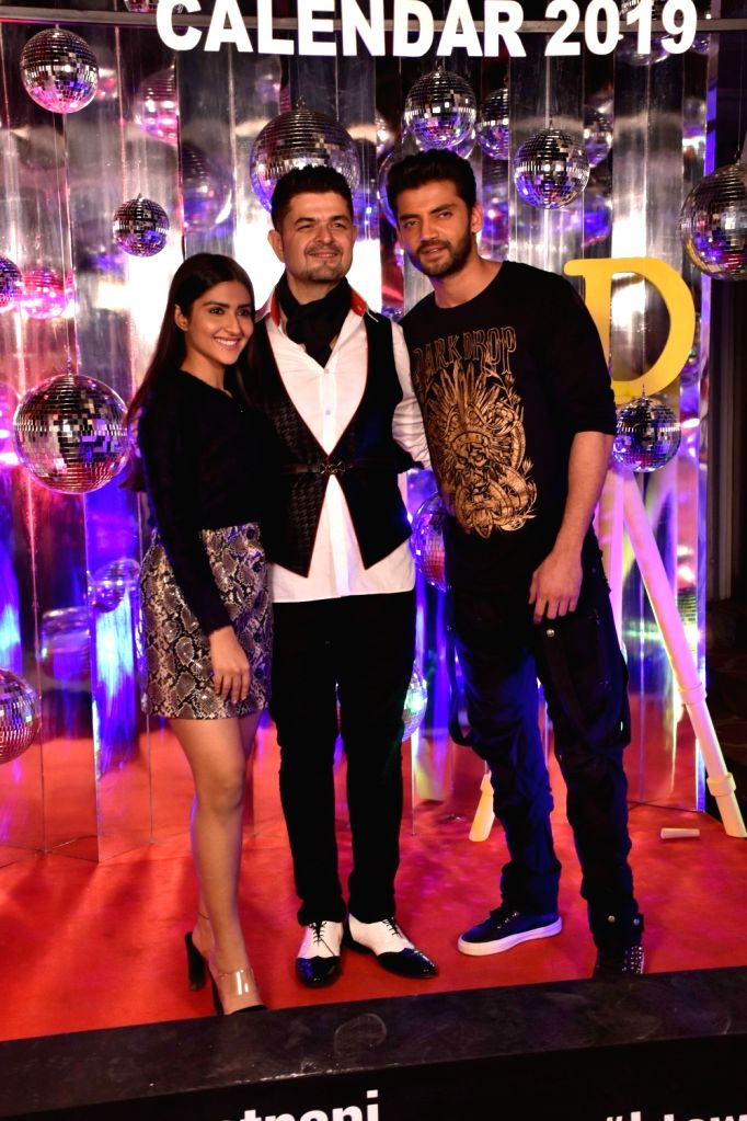 Dabboo Ratnani with actors Zaheer Iqbal and Pranutan Bahl at the launch of his calendar in Mumbai, on Jan 28, 2019. - Zaheer Iqbal and Pranutan Bahl