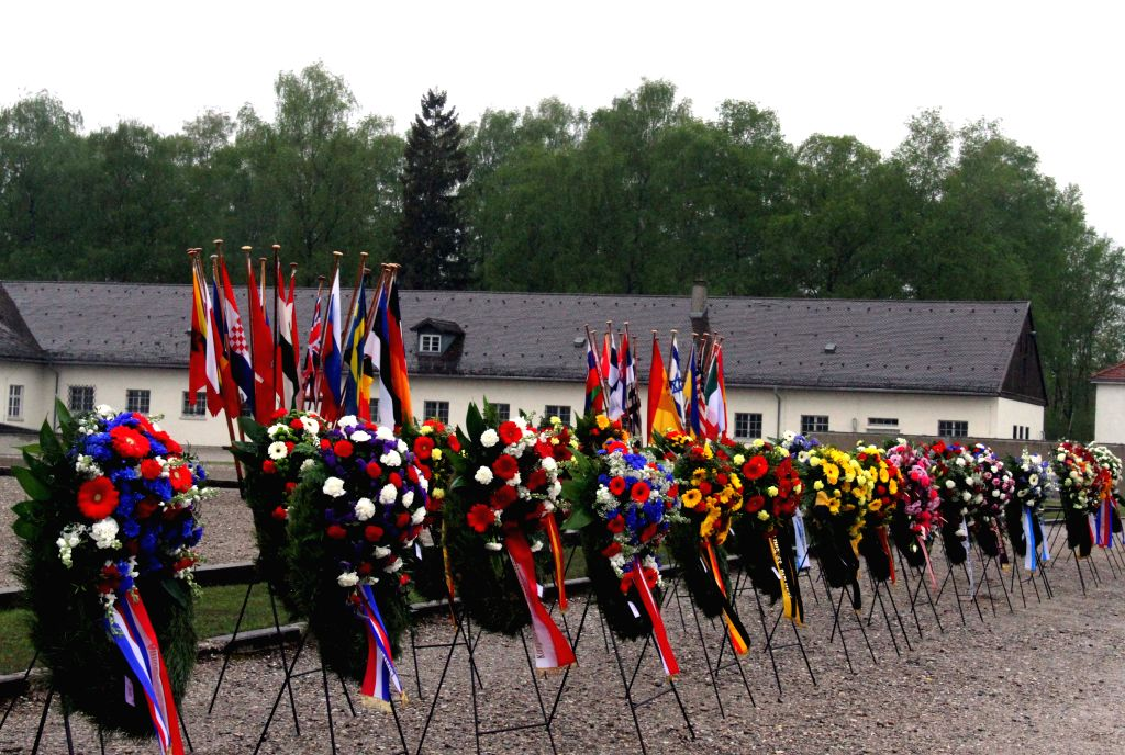 Photo taken on May 3, 2015 shows wreaths placed at a ceremony in the Dachau Concentration Camp in Dachau, Germany. German Chancellor Angela Merkel on Sunday delivered ...