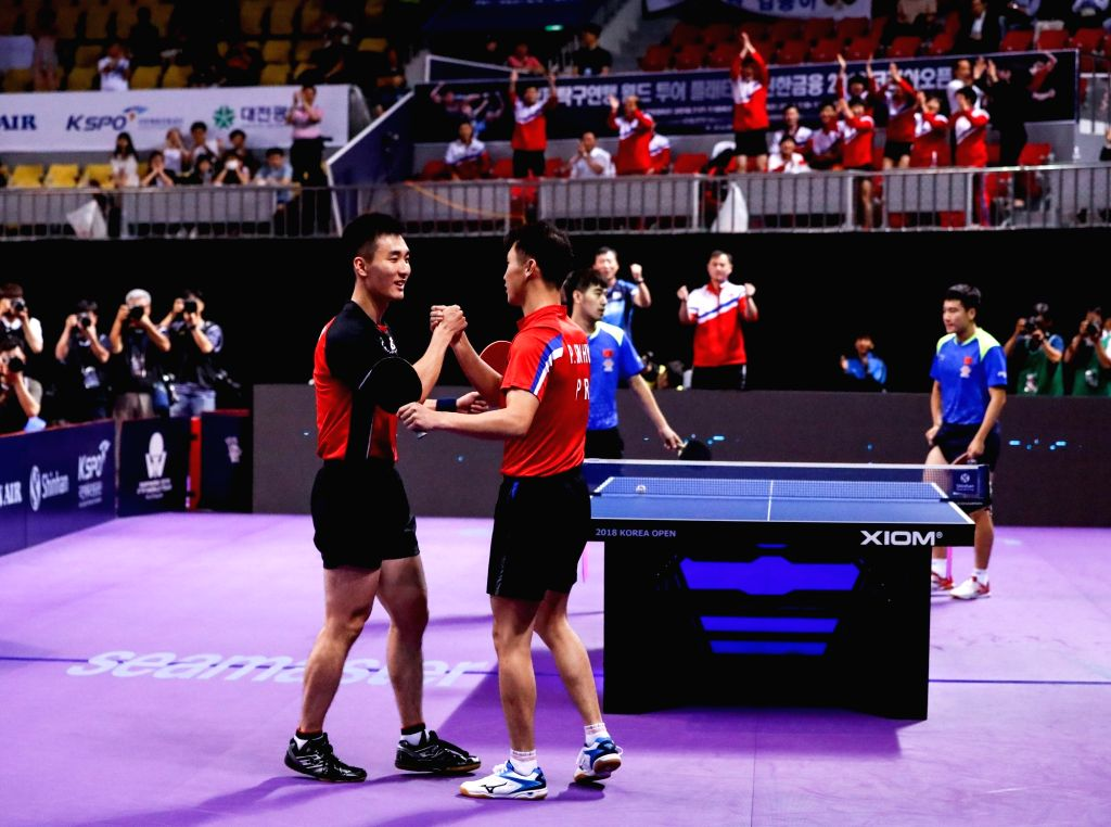 DAEJEON, July 20, 2018 - Lee Sangsu (front L) of South Korea and Pak Sin Hyok (front R) of the Democratic People's Republic of Korea (DPRK) celebrate after the men's doubles quarterfinal match ...