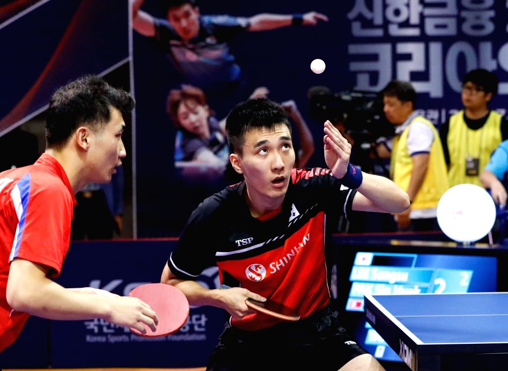 DAEJEON, July 20, 2018 - Lee Sangsu (R) of South Korea and Pak Sin Hyok of the Democratic People's Republic of Korea (DPRK) compete during the men's doubles quarterfinal match against Liang ...