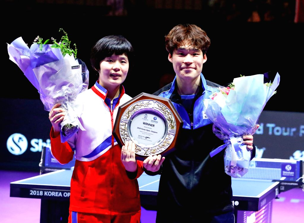 DAEJEON, July 21, 2018 - Jang Woojin (R) of South Korea and Cha Hyo Sim of the Democratic People's Republic of Korea (DPRK) pose on the awarding ceremony after the mix doubles final match against ...