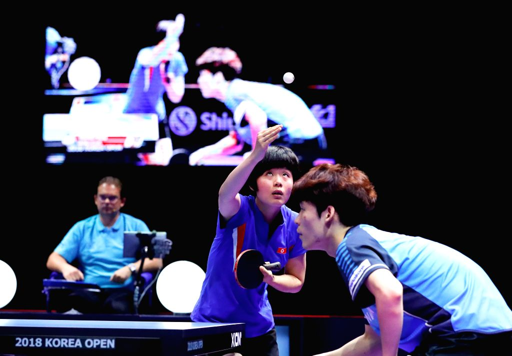 DAEJEON, July 21, 2018 - Jang Woojin (R) of South Korea and Cha Hyo Sim (C) of the Democratic People's Republic of Korea (DPRK) compete during the mix doubles final match against Wang Chuqin/Sun ...