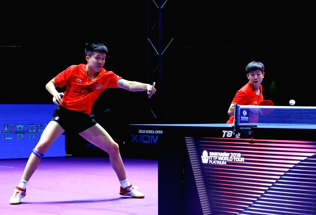 DAEJEON, July 21, 2018 - Wang Chuqin (L)/Sun Yingsha of China compete during the mix doubles final match against Jang Woojin of South Korea and Cha Hyo Sim of the Democratic People's Republic of ...