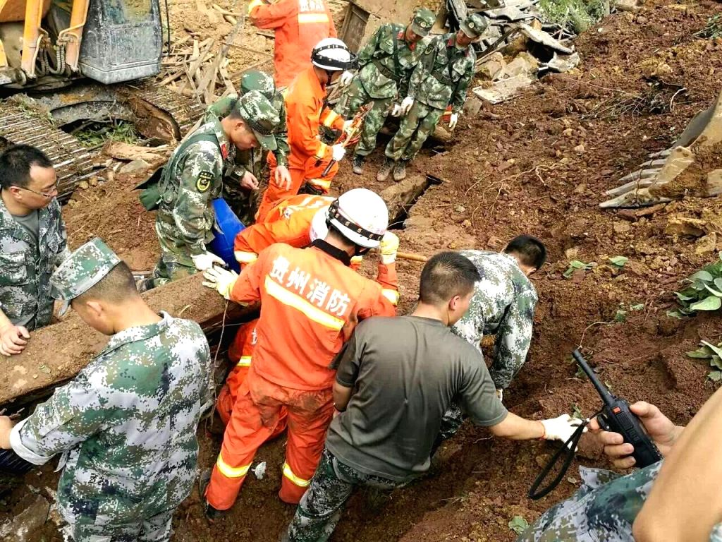 DAFANG, July 1, 2016 - Rescuers work at the accident site after a rain-triggered landslide hit Pianpo Village, Dafang County in the city of Bijie, southwest China's Guizhou Province, July 1, 2016. ...