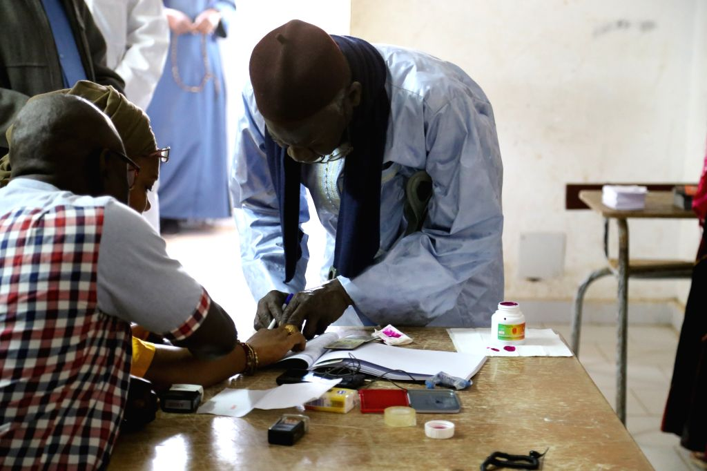 DAKAR, Feb. 24, 2019 - A voter (R) signs confirmation after voting at a polling station in Dakar, Senegal on Feb. 24, 2019. Senegalese presidential election started Sunday at 08:00 local time (08:00 ... - Idrissa Seck